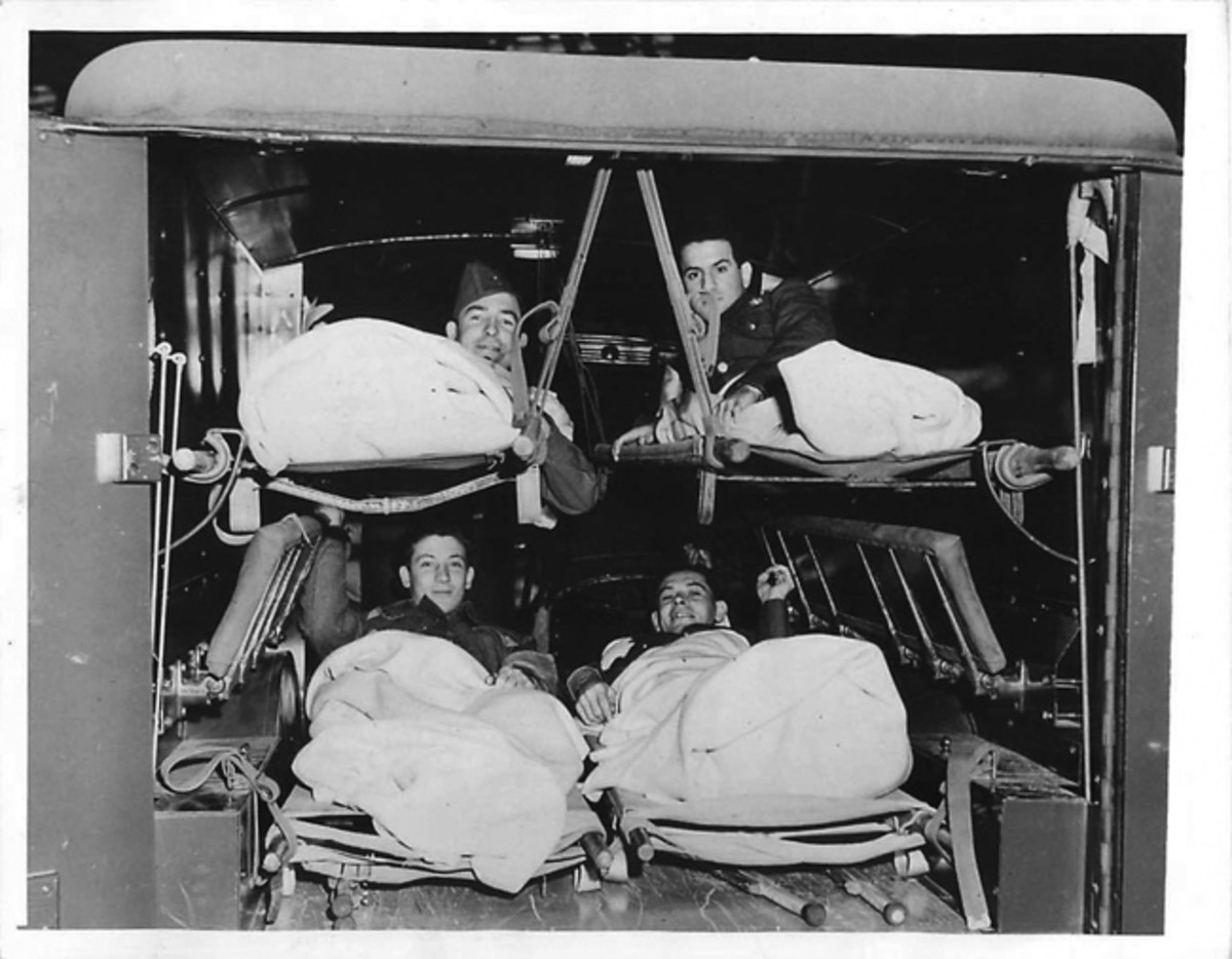 Headed for Halloran General Hospital, a group of repatriated American prisoners of war are shown in an Army WC-54 ambulance shortly after they were landed from the exchange liner Gripsholm, 1944. Courtesy of Cam Finlay