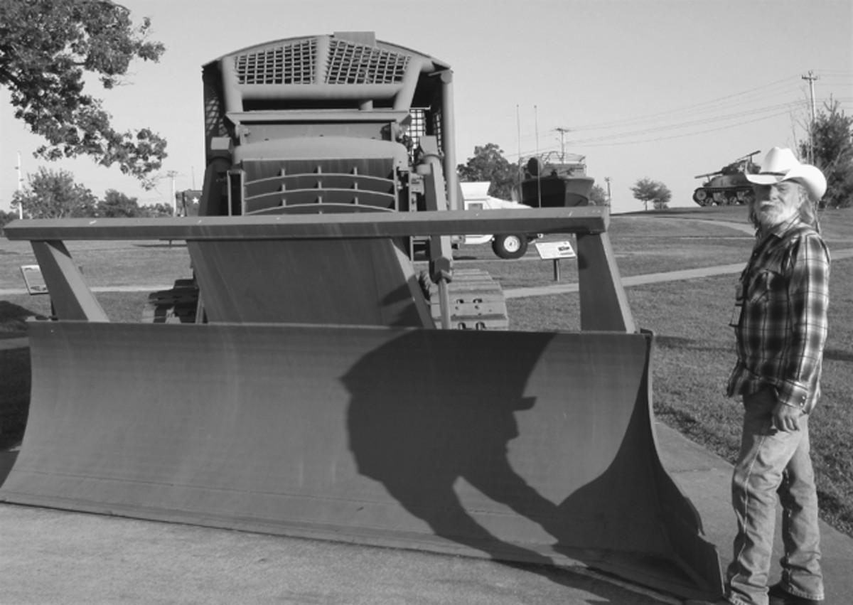 "Dave Flinn found an exact duplicate of ""his baby"" — a Vietnam-era D7E Caterpillar dozer at Ft Leonard Wood, Missouri, during the 2017 MVPA Route 66 Convoy. Photo by Mark Sigrist"