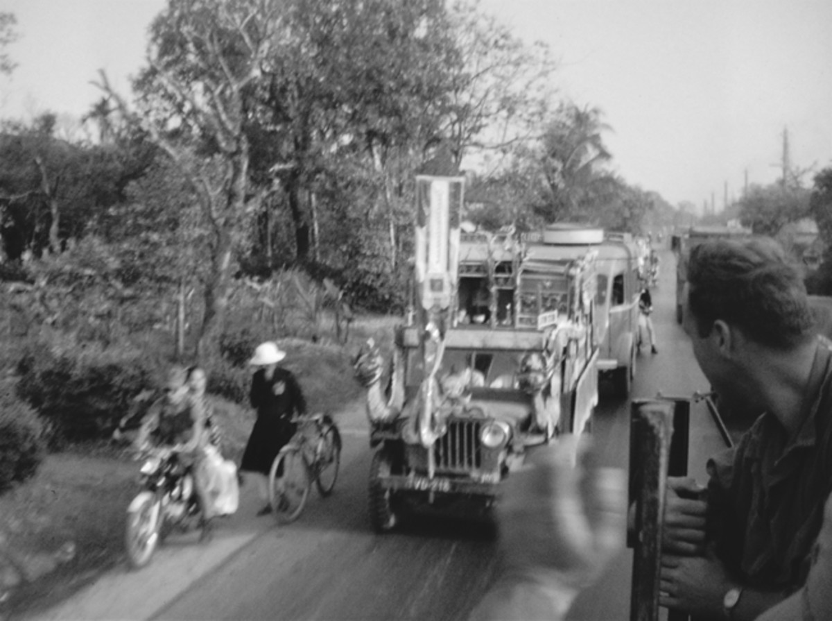 Convoy passing local traffic on the hardtop road near Hue City.
