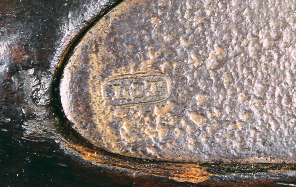 "A close up of the ""L & T"" marking in a rectangle border found on the lockplate that helped me recognize this old friend from 35 years earlier."