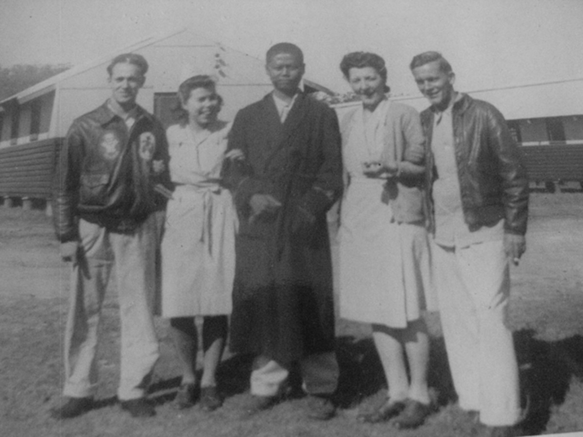 Photographed with serving at the 42nd General Hospital, Mangold is seen here with an ex-POW (of the Japanese), fellow nurse Ingrid Magneson and unnamed US air crew.
