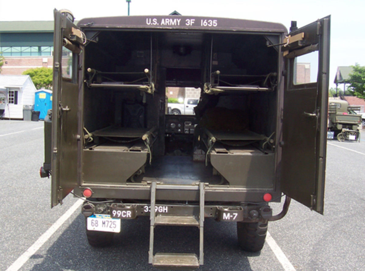 1968 Kaiser M725 ambulance owned by C. McEwen, that he displayed with the doors open to view the patient compartment.