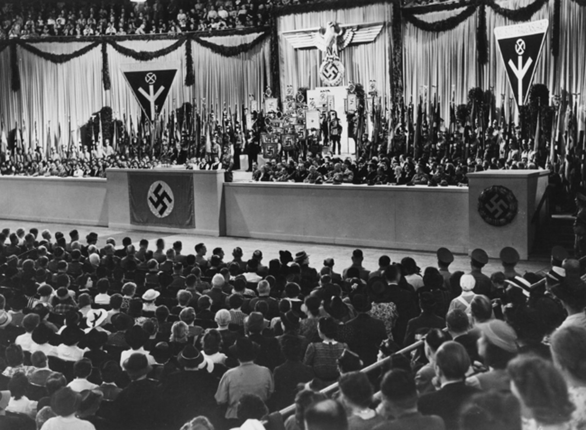 The NS-Frauenschaft empowered women to take part in the national movement as it swept over Germany. This photo was taken at the NS-Gaufrauenschaft Berlin rally in the Sportpalast. It shows Reichsfrauenführerin GertrudScholtz-Klink standing with (from left) Joseph Goebbels; the Italian Ambassador Dino Alfieri; Deutschen Arbeitsfront (DAF) leader Robert Ley; and the leader of the NS-Hauptamts NS-Frauenschaft, Erich Hilgenfeldt (Photo by Ullstein Bild via Getty Images)