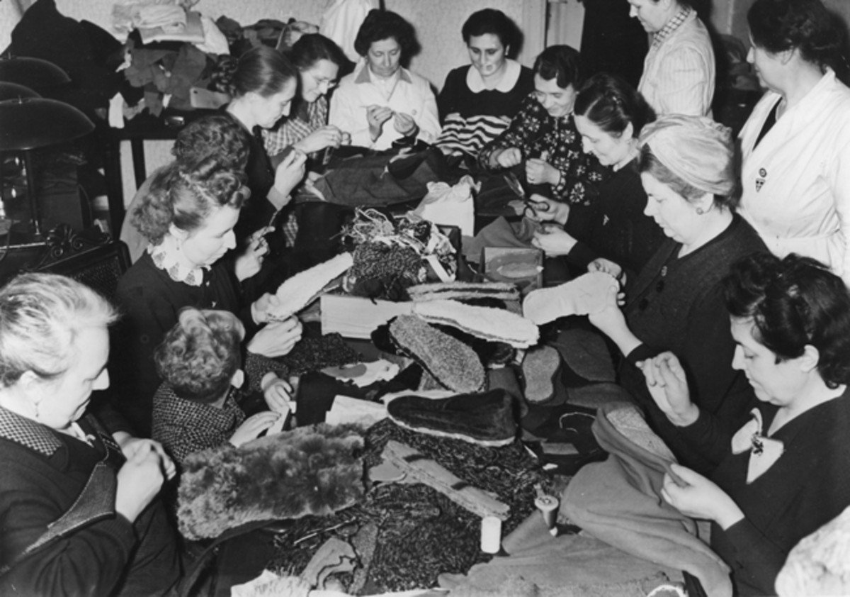 NS-Frauenschaft women sewing winter clothing accessories for German solders fighting on the Eastern Front. (Photo by Ullstein Bild via Getty Images)