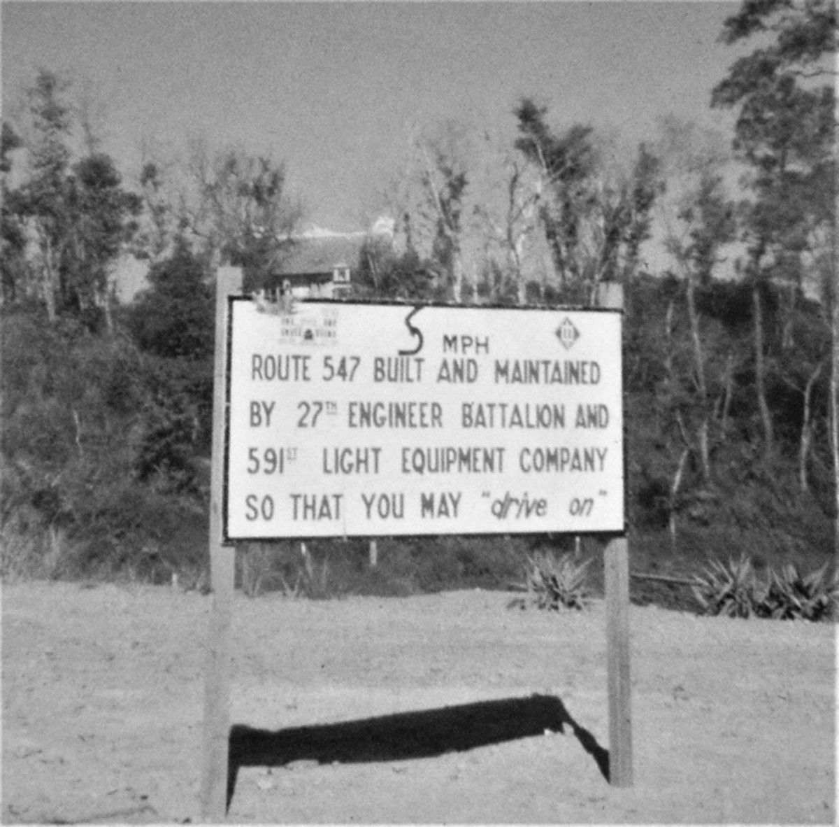 Sign on Highway Route 547 announcing construction by the 591st Engineer (Light Equipment) Company near the northern Vietnam city of Hue leading into the A Shau Valley.