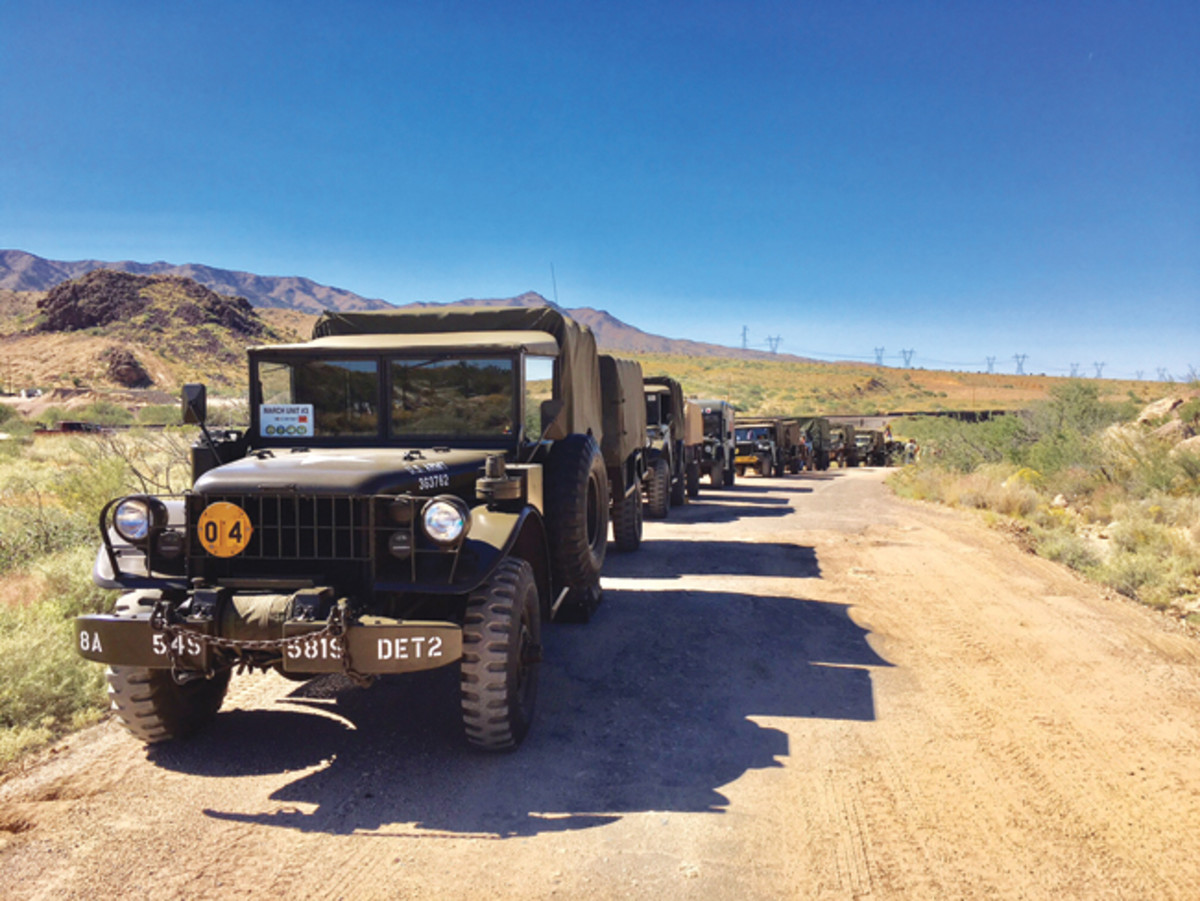 "Keeping 'em rolling: Gil on the trail with his ""Conestoga wagon"" — the 1962 M37B1 with a M101A1 ""camper."""