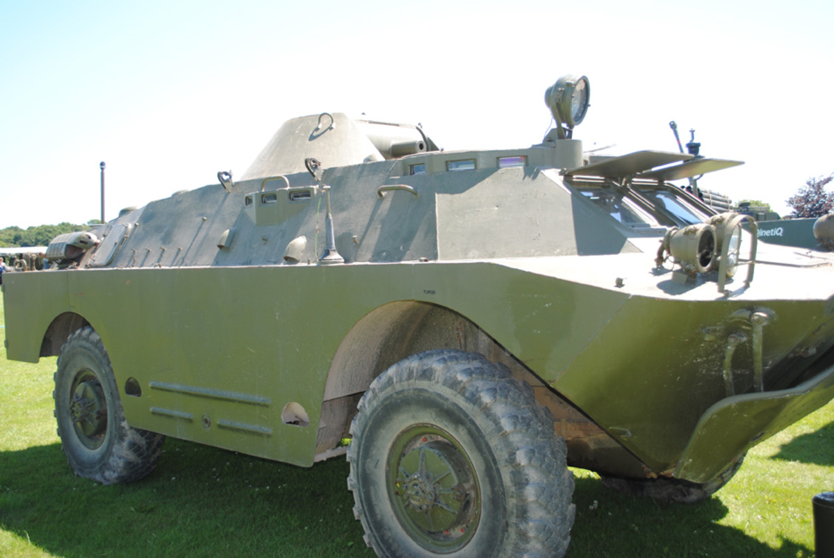"""The BRDM-2 was fitted with a pair of """"belly wheels"""" to prevent it from becoming bogged down in rough terrain, and one of these is just visible here. As a reconnaissance vehicle, it carried powerful radio sets and aerials to transmit clear signals."""