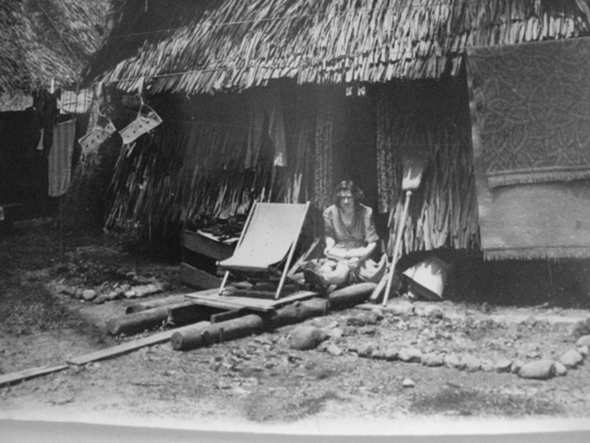 Grass hut accommodations at 54th Evacuation Hospital, Kaybee mission, Milne Bay.