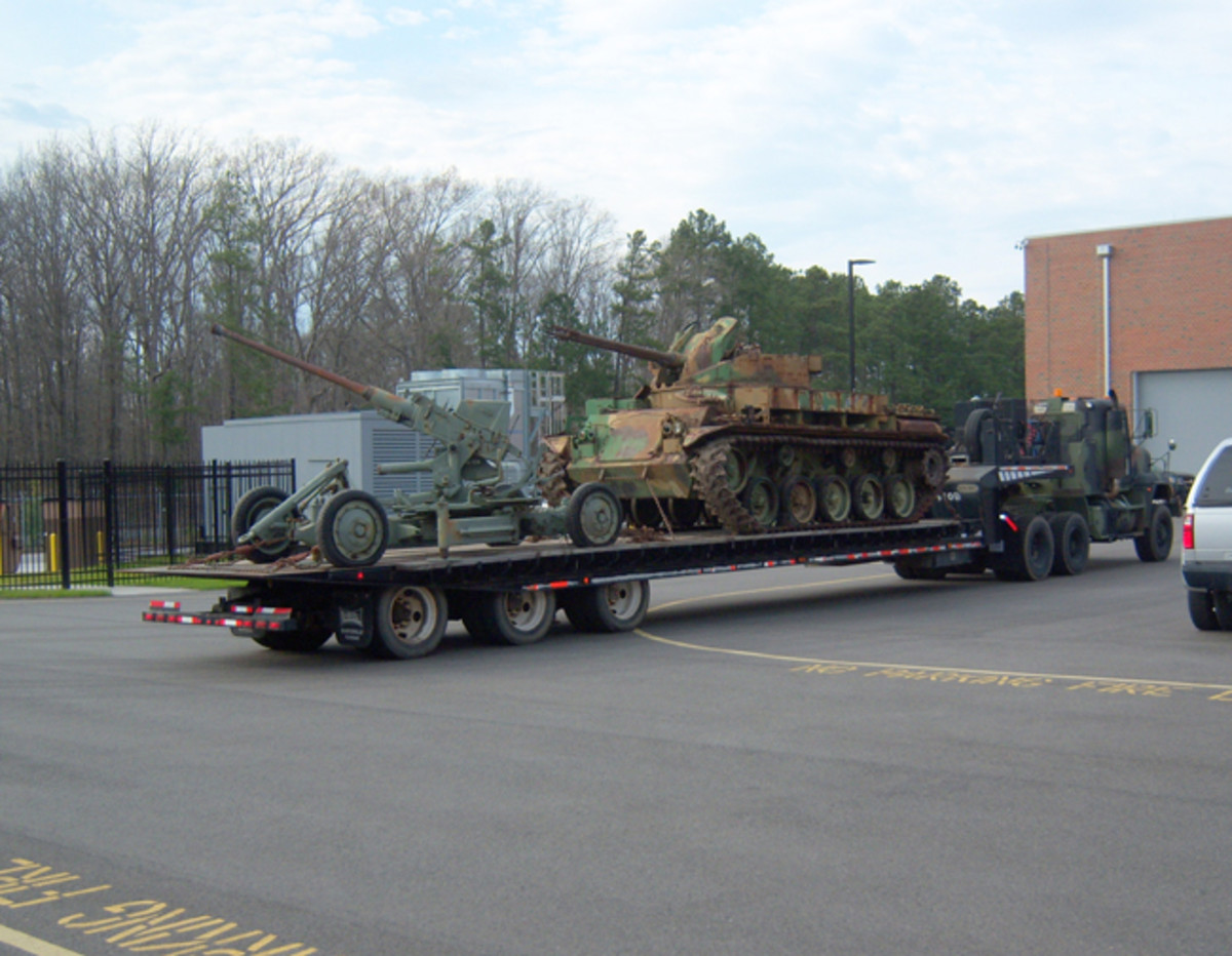 The Bofors and Duster arrive at the VANG Joint Force Headquarters.