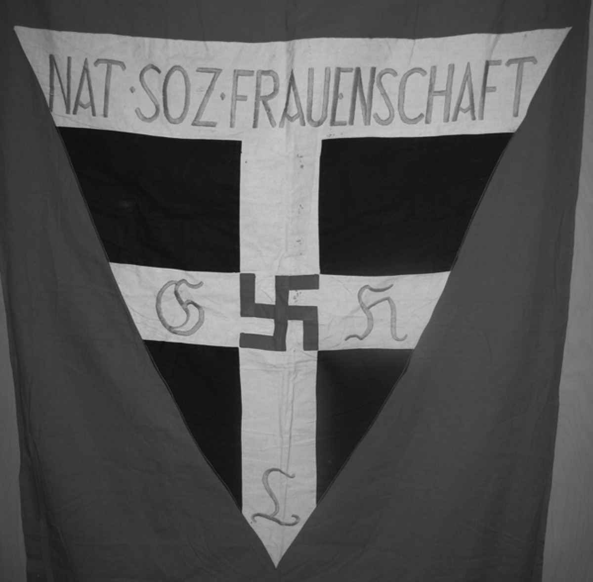 Hand-sewn NSF banners were often hung on the walls of the women's meeting places to give them a more formal appearance.