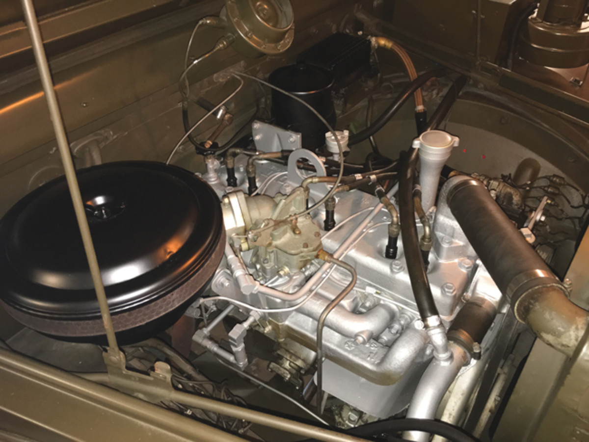 The T245, 230 cu. inch 6-cylinder engine got a 'freshening up' of Dodge high temperature silver paint. The use of aluminum foil to cover everything that wasn't going to get painted made this an easy task.