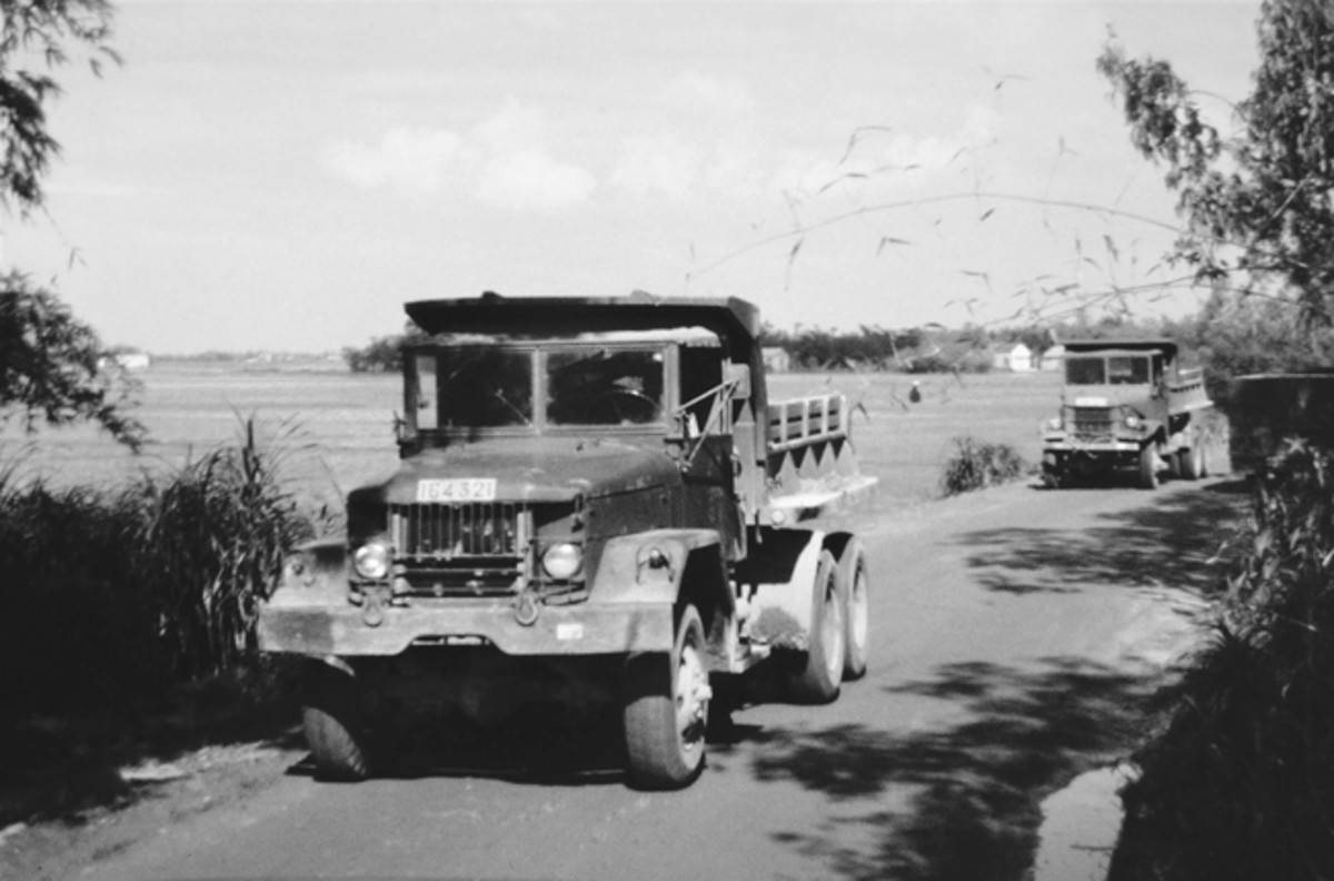 A pair of ARVN (Army, Republic of Vietnam) dump trucks. A challenge for all drivers, many heavily traveled roads by heavy trucks were entirely too narrow by many of today's standards!