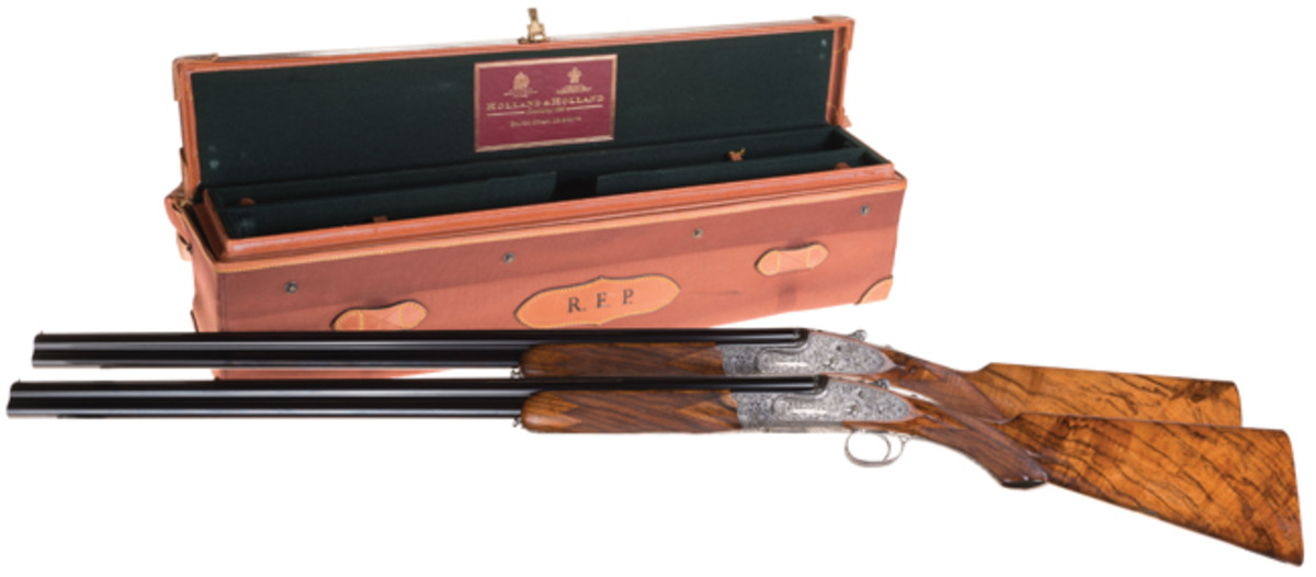 Pair of Hand-Detachable Side Lock Philippe Grifnee Master Engraved, Gold Inlaid Holland & Holland Royal Deluxe Over and Under Shotguns in Desirable 28 Gauge with Case, Full Complement of Accessories, and Factory Letter