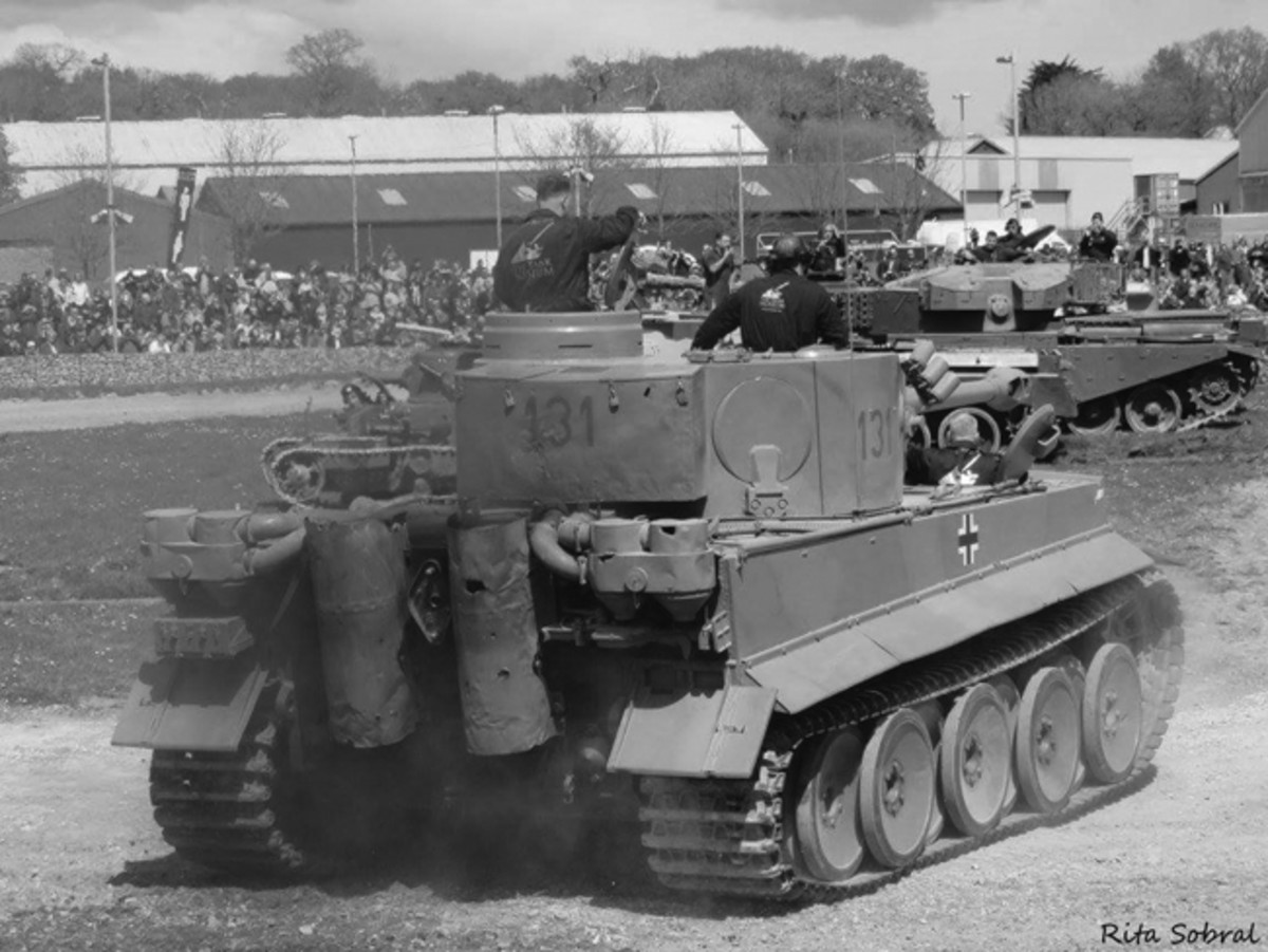 A rear view of Tiger 131 at speed in the arena, shows the battle damage remaining on sheet metal portions of the turret and rear chassis. One lock on the turret storage bin is still locked as it was found in 1943. The camouflage on Tiger 131 has been restored based on extensive research and chips of areas that had not been repainted over the years.