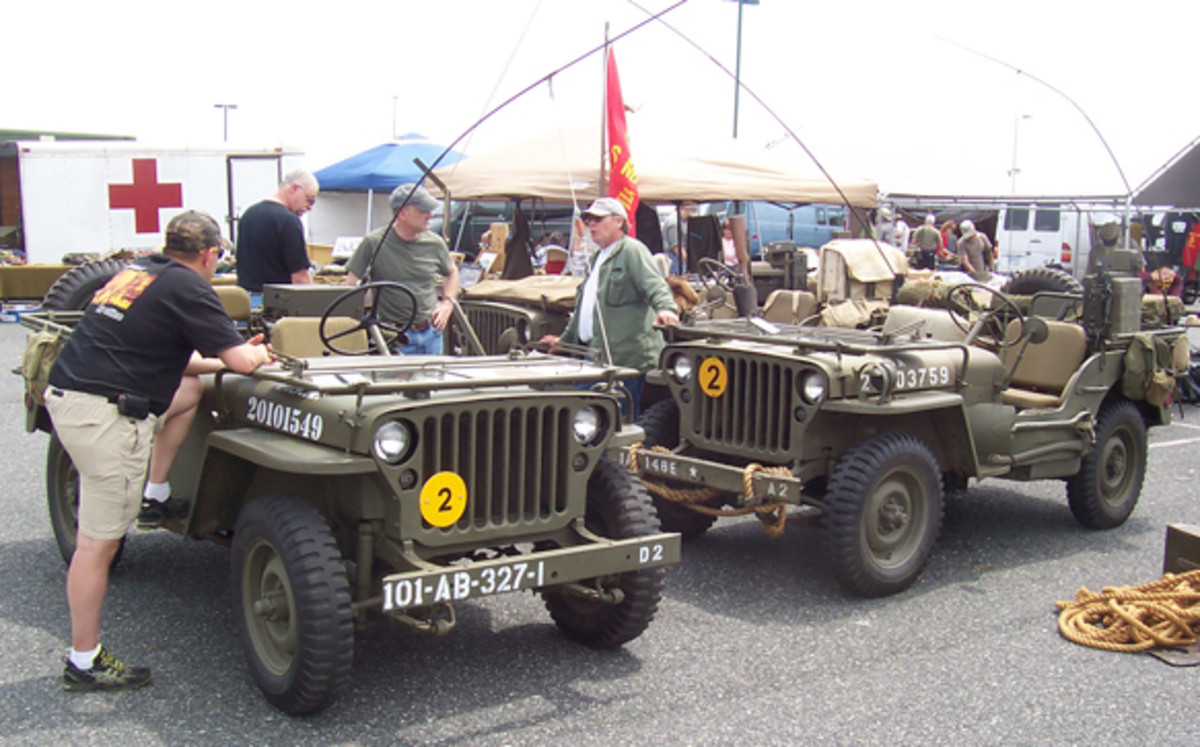 Fleet of three WWII jeeps ready for duty in the vendor area.