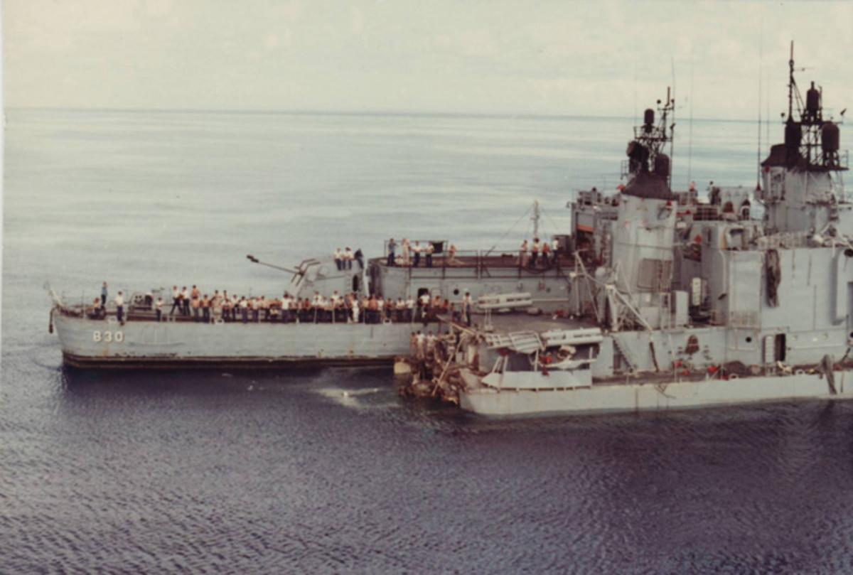 The USS Frank E. Evans stern section alongside the USS Larson
