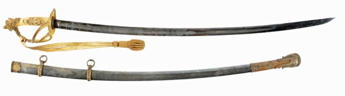 Important Civil War saber with silver scabbard presented to Capt. James Bliss during the war era by veterans of Company B, 8th New York Cavalry. Sold for $12,000 - Image Morphy Auctions