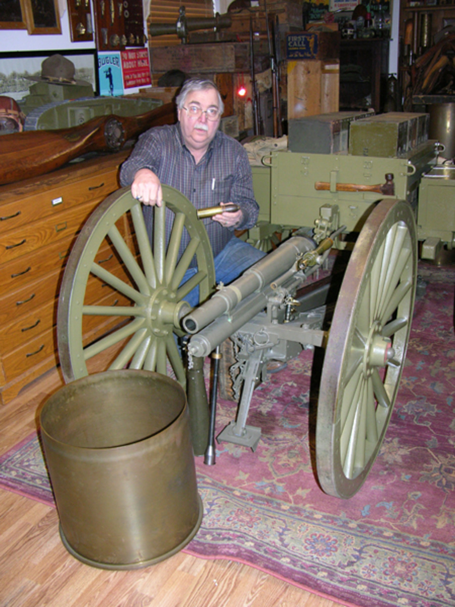 Hayes Otoupalik with the iconic WWI US Model 1917 37mm 1 pdr cannon displayed along side of a German Big Bertha brass shell case. This one pounder is the only known example in private hands in the USA. Hayes says it is really a joy to shoot!