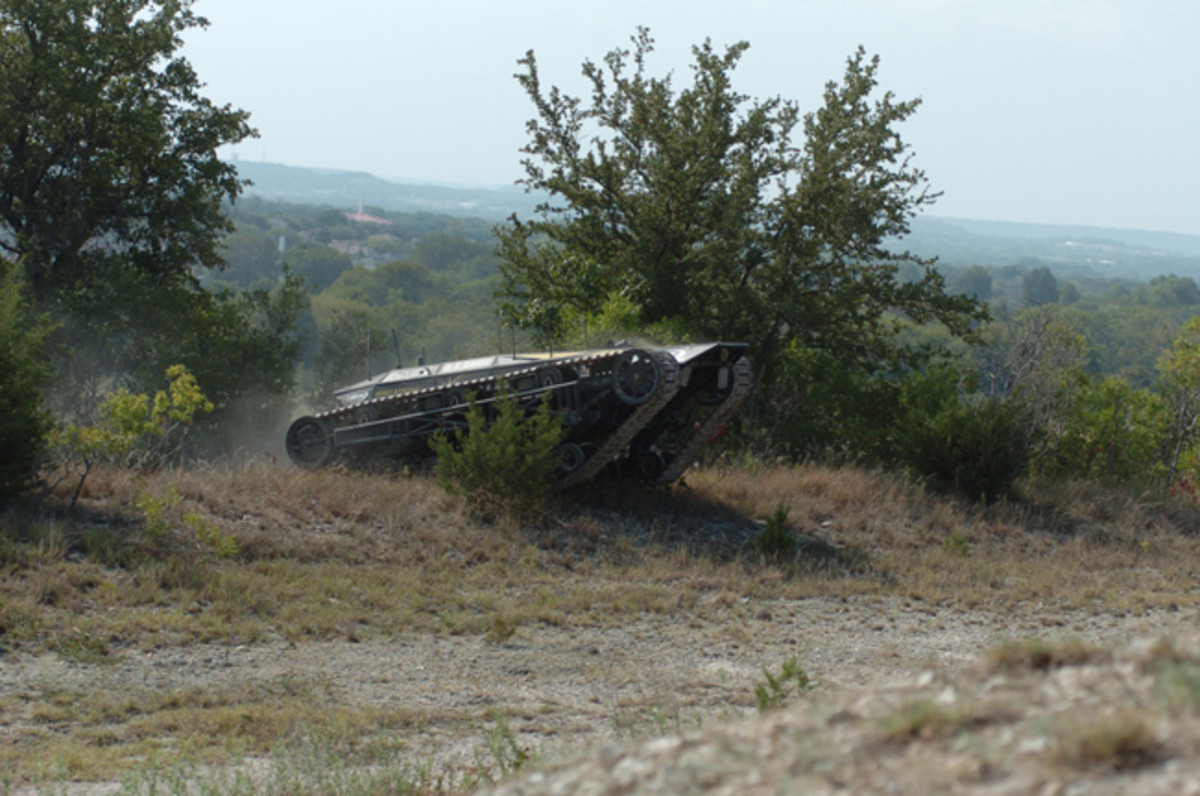 The RIPSAW-MS1 demonstrates its off road capabilities during a lanes exercise at the Fort Hood Robotics Rodeo. The RIPSAW is equipped with six claymore mines, can carry 5,000 pounds and tow multiple military vehicles. The RIPSAW is designed to be an unmanned convoy security vehicle and takes the Soldier out of harm's way.