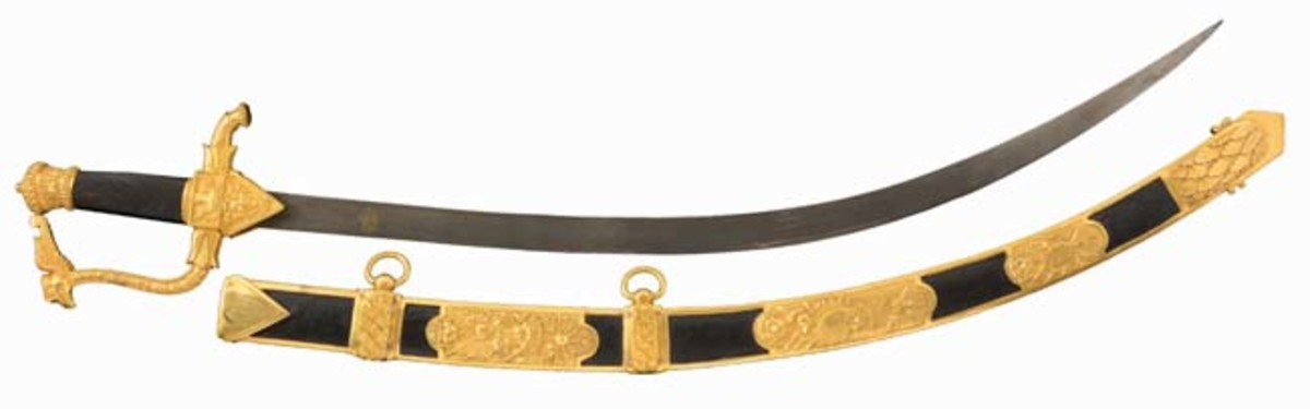 Artistically and historically significant Imperial Russian Napoleonic sword of Russian Prince Ivan Ivanovich Odoevsky (d. 1814), solid gold ormolu adornment, Cyrillic inscription and 1810 date, 41 inches overall. Sold for $30,000 - Image Morphy Auctions