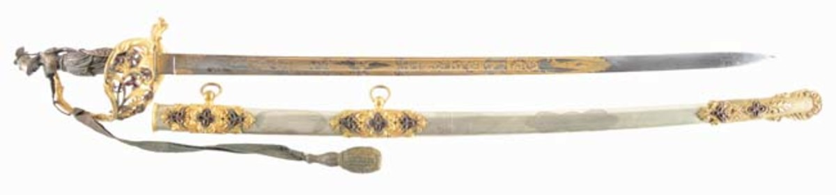 Extremely fine and elaborate statue-hilted and jewel-inlaid Civil War presentation sword, blade by Klauberg, retailed by Schuyler Hartley and Graham, NY. Sold for $17,835 - Image Morphy Auctions