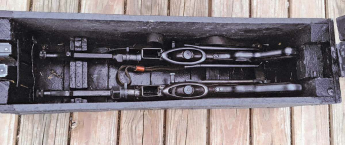 The box was clearly designed to hold the submachine guns, but why only two? There are holes on the ends to accommodate rope handles — when loaded with two weapons and the accompanying accessories, the box it quite heavy.