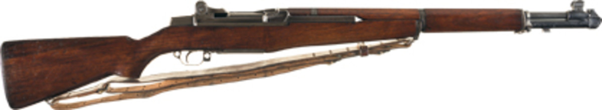 Lot 1535: An extremely rare early production gas-trap M1 Garand rifle with a scarce theater made blast deflector and authentication letter brought $37,375.