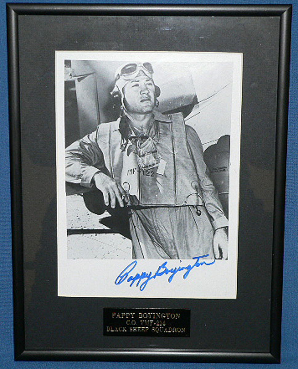 Lot 2: WWII Flight Ace Pappy Boyington signed and framed photo image.