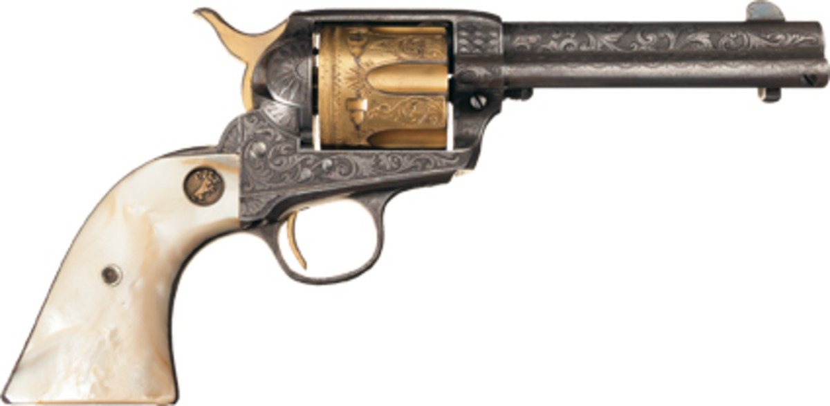 Lot 3160: A gorgeous, factory engraved, silver & gold plated Colt SAA with pearl grips also sold for $69,000.