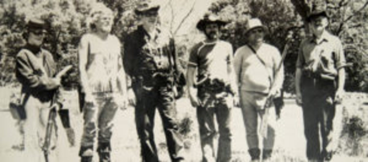 "Age fourteen: I am the geeky one on the far left of the picture, cradling my ""Zouave"" rifle. Dad is on the far right, wearing a Model 1858 Hardee hat that was too small for him, but that I begged him to wear to that particular shooting event. We know which of the two was the REAL trooper that day!"