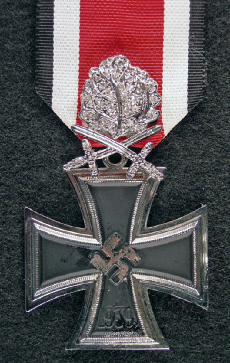 [This image was on the top of page 53 of the original article] Nowotny earned this Knights Cross with Oak Leaves and Swords after downing 200 enemy planes mostly on the Eastern Front. It was commandeered from his billet after his death by his wing man.