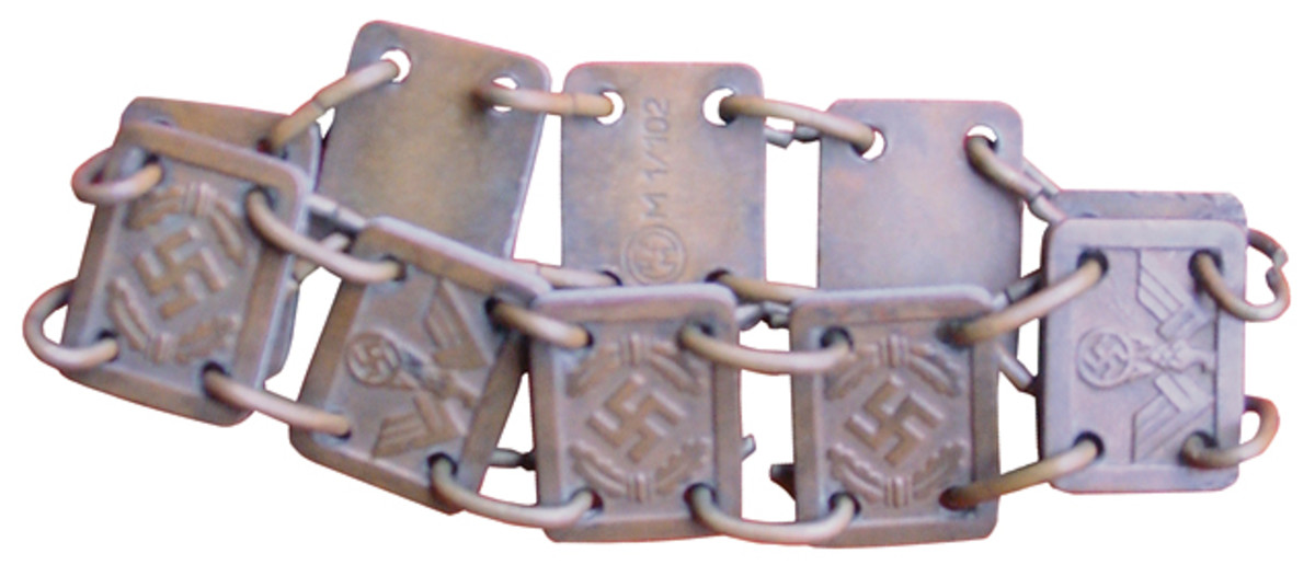 One of the few WWII items I received after my grandfather's death was this bracelet. I hadn't realized that it was something other than a piece of wartime jewelry that he had liberated.