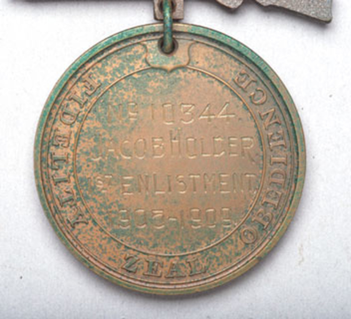 Medal with growth on reverse from having been stored on foam in a plastic box.