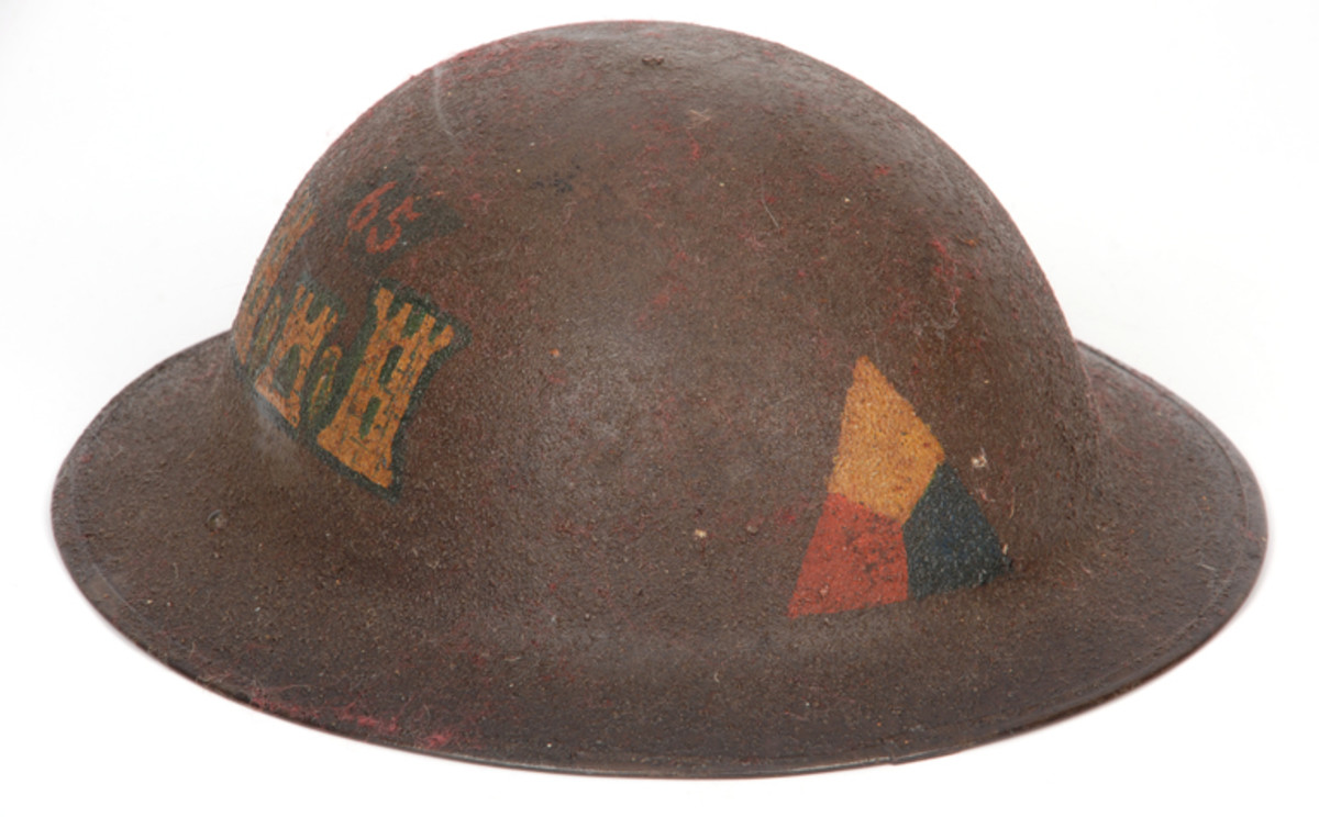 WWI helmet that was varnished and stored in red wool. Now it is covered with red fuzz.