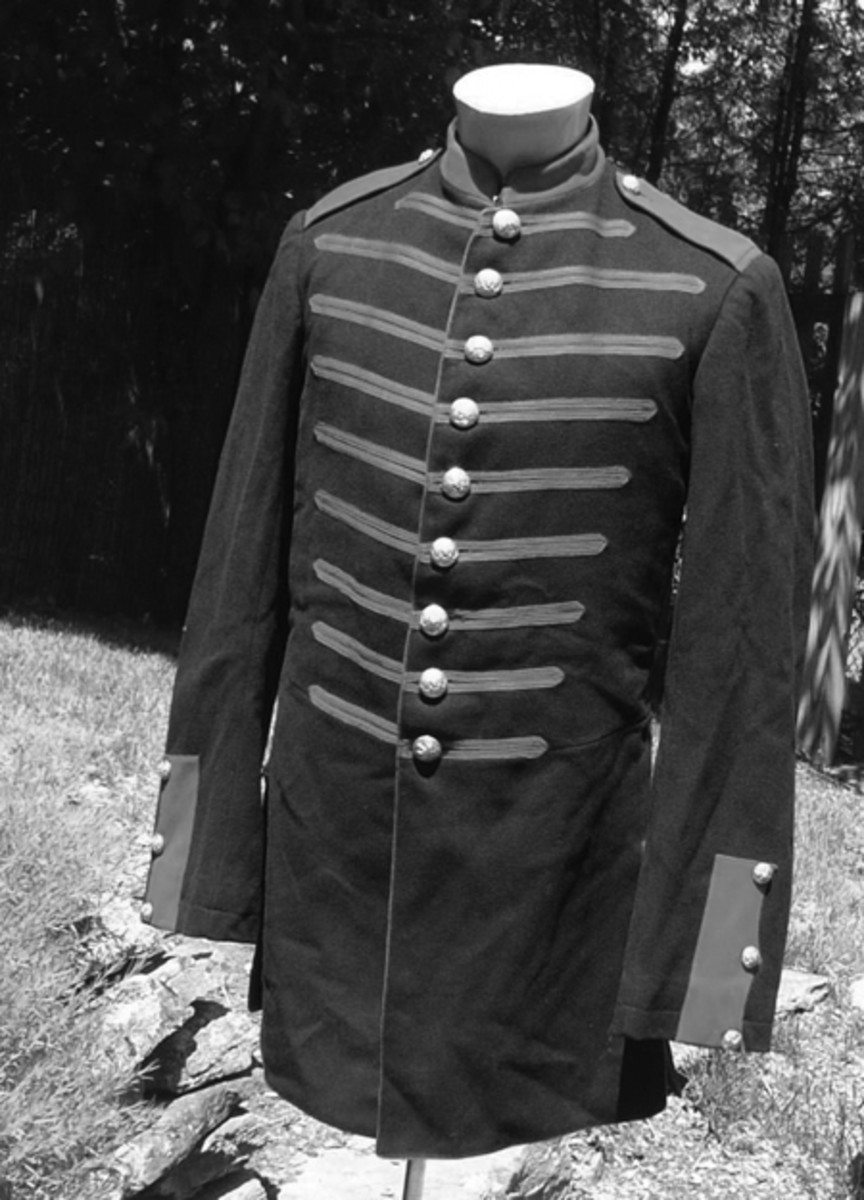 Steve says he is seeing more interest in Indian War and Spanish American material. He sold this rare 1885 Indian War light artillery bugler's coat. There were only ten batteries of US light or field artillery from 1866 to 1898 and their uniforms are correspondingly scarce. The other batteries in the five regiments of US artillery authorized during the period were assigned to coast artillery. Their coats followed the foot patterns with long individual plackets on the tails. Light artillery coats, like this one, followed the mounted pattern with a wide W-shaped placket on the tails.