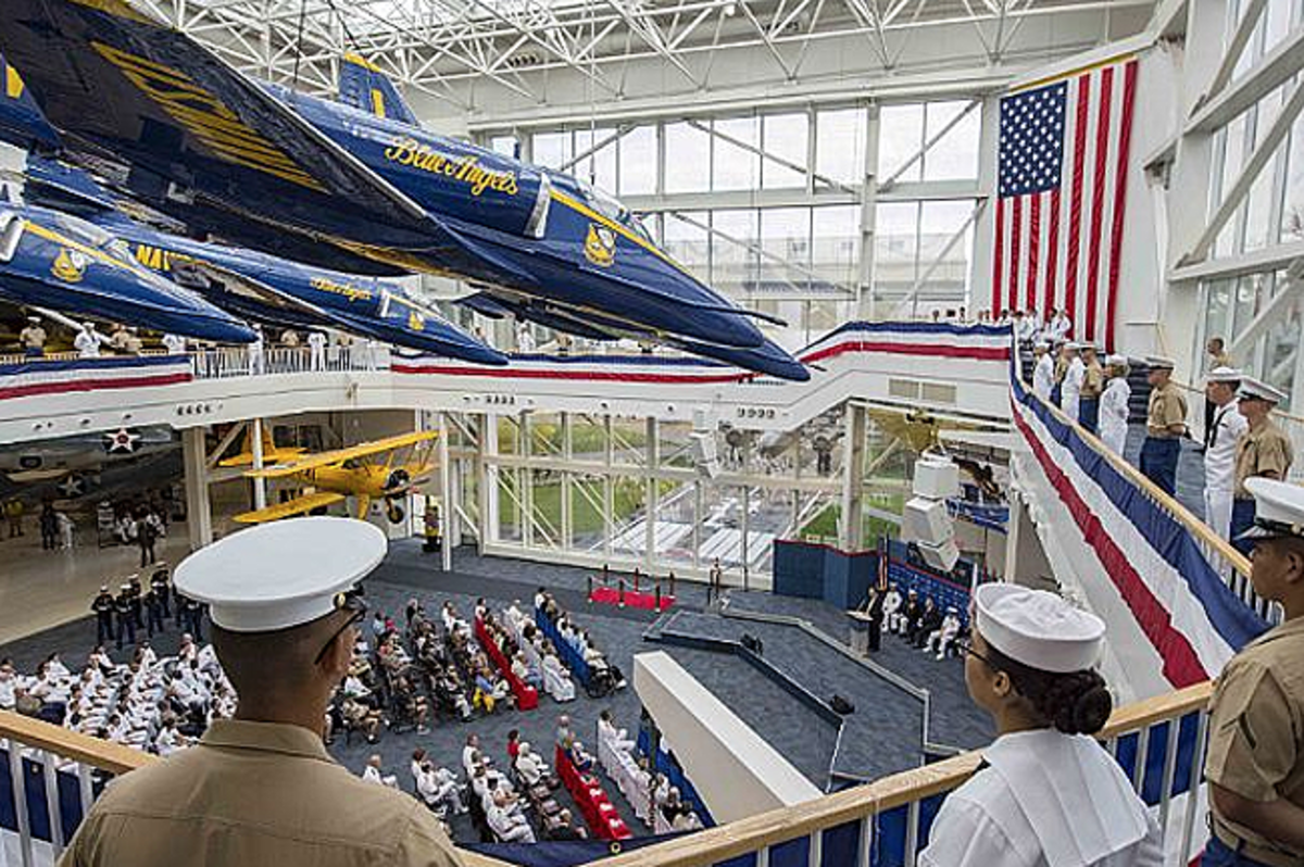 PENSACOLA, Fla. (June 5, 2017) Sailors and Marines man the rails overlooking a commemoration of the 75th anniversary of the Battle of Midway. The event, presented by Navy Medicine Operational Training Center, was held at the National Naval Aviation Museum on Naval Air Station Pensacola and featured keynote speaker retired Vice Adm. John Bird, a former U.S. 7th Fleet commander. (U.S. Navy photo by Mass Communication Specialist 2nd Class Michael J. Lieberknecht/Released)
