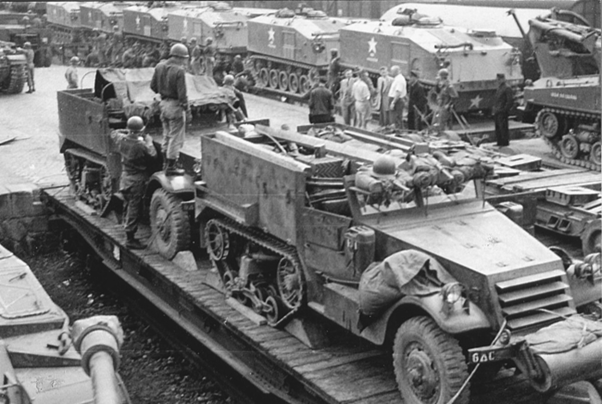Out with the old, and in with the new! Richard Detling took this photograph in Germany, ca. 1954, of train cars loaded with half-tracks in the foreground, and behind them, their replacements: the M75s.