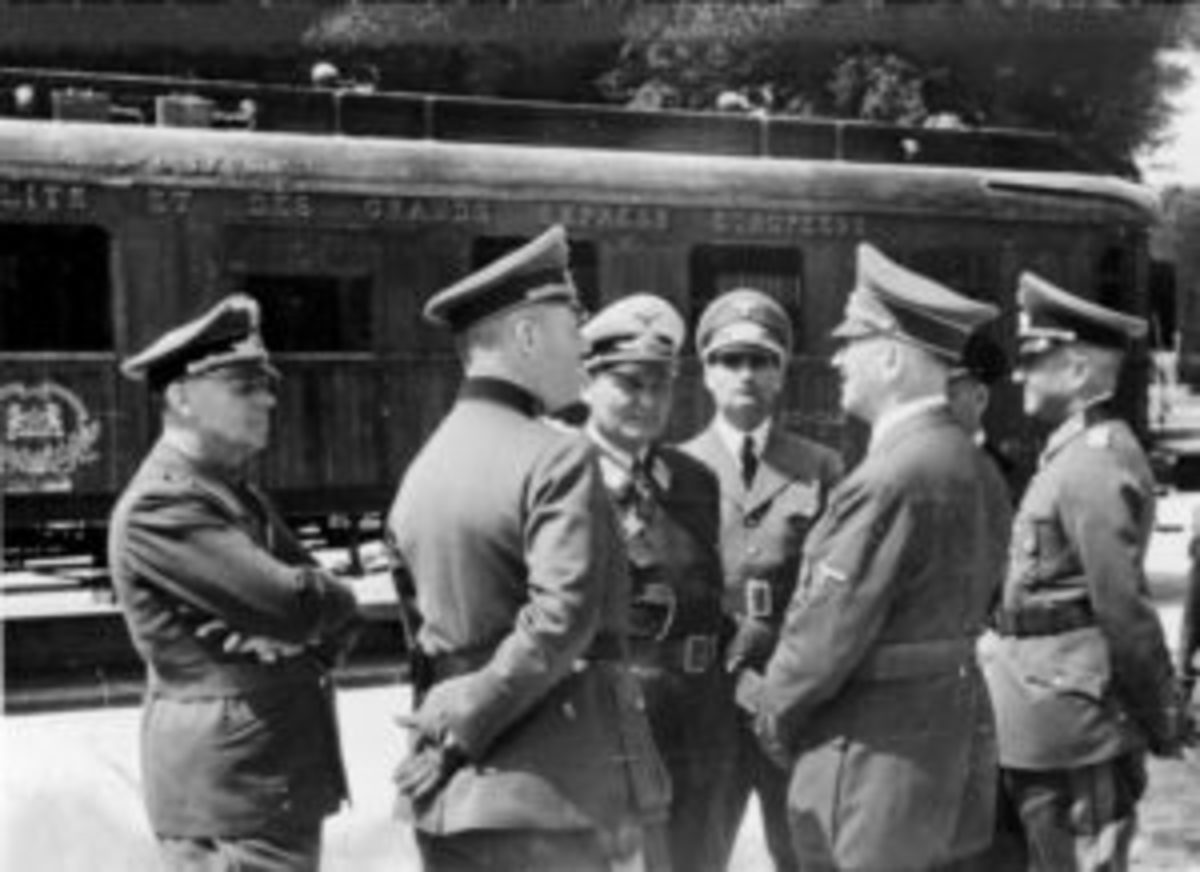 The car would serve as the location of a second armistice in 1940, this time subjugating France to German forces. Seen here are Left to right: Joachim von Ribbentrop, Wilhelm Keitel, Hermann Göring, Rudolf Hess, Adolf Hitler, Erich Raeder partially obscured and Walther von Brauchitsch in front of the Armistice carriage in 1940.