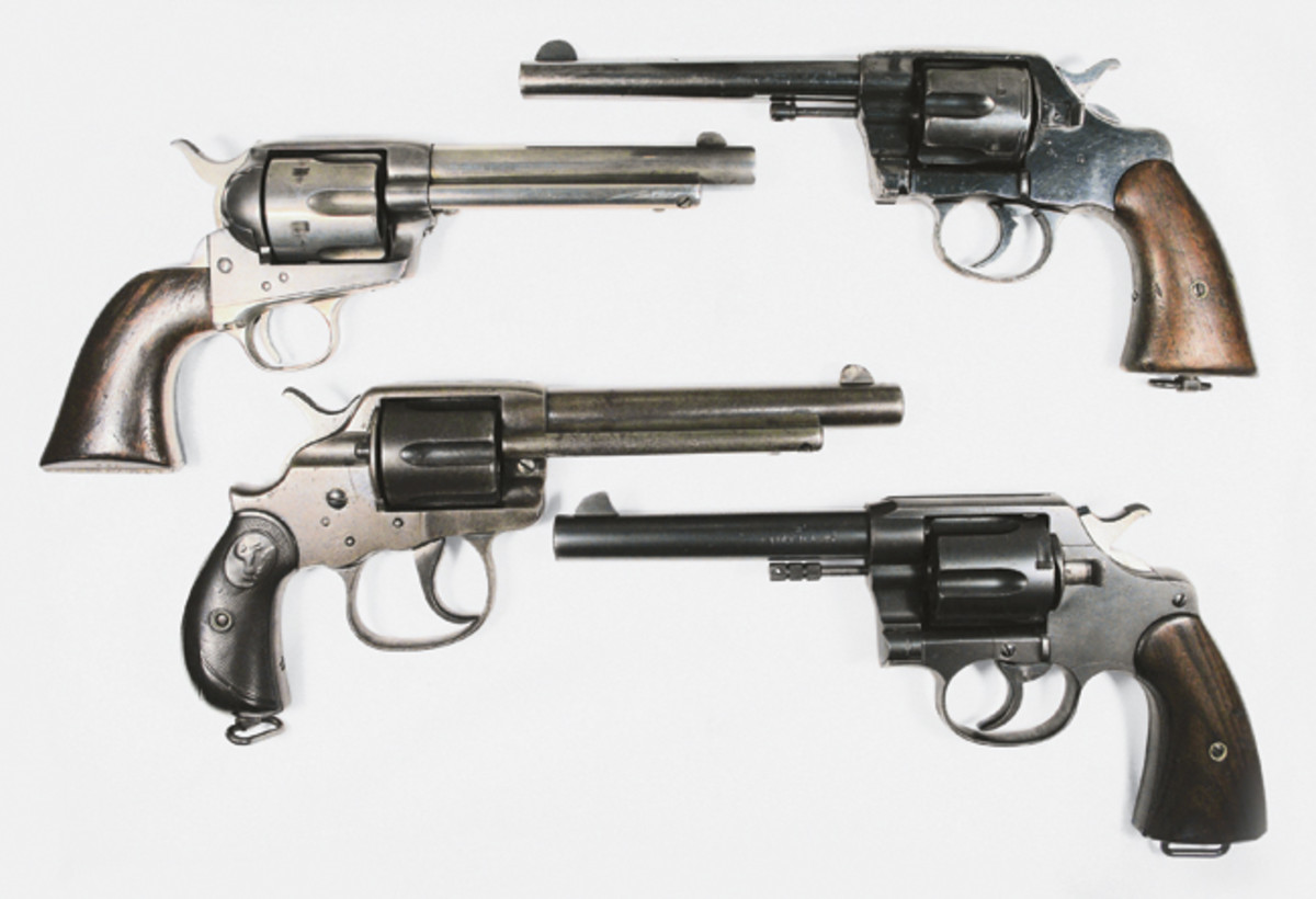 The four varieties of Philippine Constabulary handguns include, Top, right: Colt Model 1901, .38 caliber. 2nd from top: Colt SA artillery in .45 long Colt. 3rd from top: Colt model 1902 made for the Philippine Constabulary with large trigger guard. Bottom: Colt Model 1909, .45 caliber.