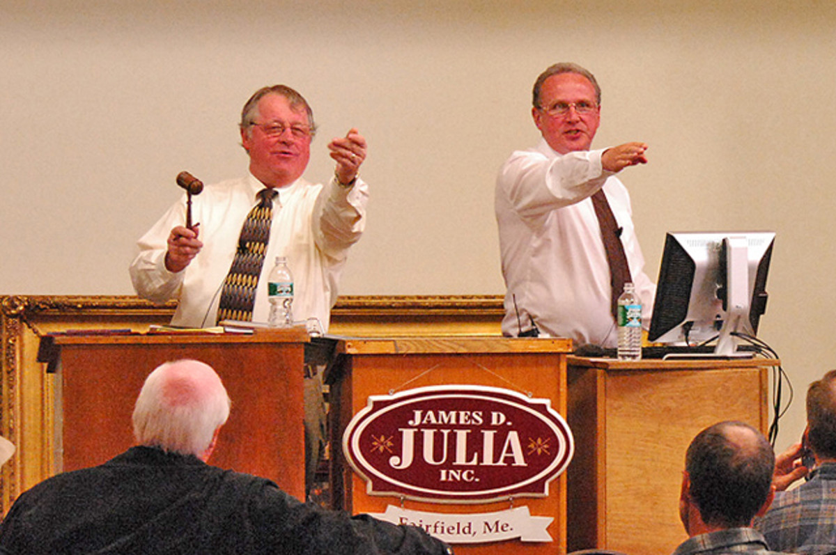 James D. Julia, (left) president and owner of the auction company, along with CEO Mark Ford on the auction block conducting a sale.