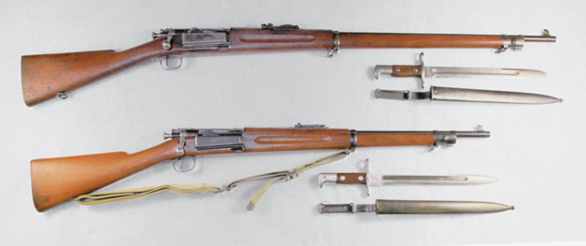 An example of the special Krag rifle with full stock made for the Philippine Constabulary is shown below a standard length Krag. Several Krag experts believe this to be the only known example of the rifles made at the Manila Arsenal.