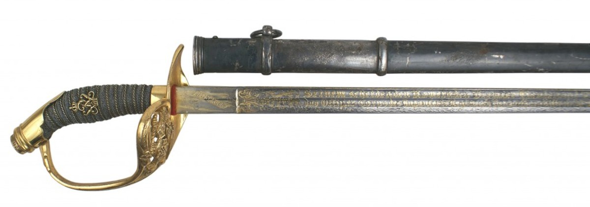 Prussian deluxe M1889 presentation sword with gilt brass pommel cap (Opening bid: $3,500).