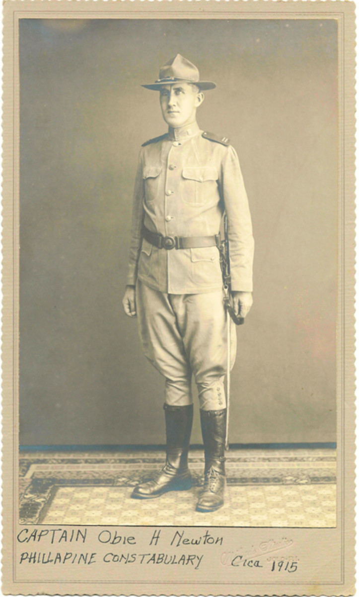Capt. Obie Newton in full Philippine Constabulary uniform posed for this photo in 1915 with a Constabulary sword.