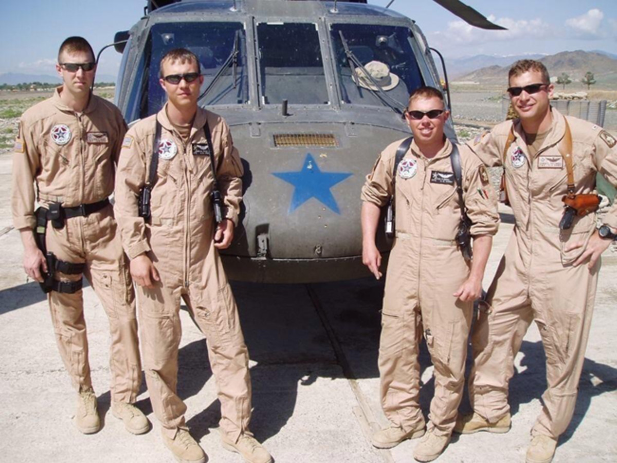 The then-Chief Warrant Officer 3 Christopher C. Palumbo (right) poses for a photograph with members of his Blackhawk crew and platoon from A Company, 3rd Battalion, 158th Aviation Regiment, days after a battle April 11, 2005, in Afghanistan. The now-retired Capt. Palumbo received the Distinguished Service Cross from Gen. James C. McConville, Vice Chief of Staff of the Army, for his actions in the April 11 battle, during a ceremony at John F. Kennedy Hall, Fort Bragg, North Carolina, June 27, 2019. (Photo courtesy of Christopher C. Palumbo)