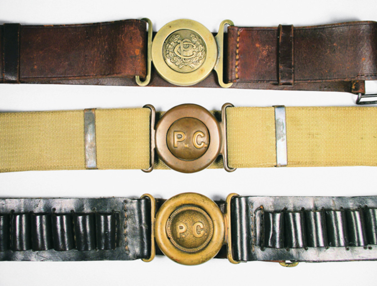 There are three varieties of Constabulary 2-piece belt buckles known. Top: Officers sword belt (currently, only three are known to exist). Middle: A flatter variety was made by Mills and usually found on a web belt. Bottom: The third type is more rounded. It was made under contract for Hartley & Graham in leather and in various cartridge configurations