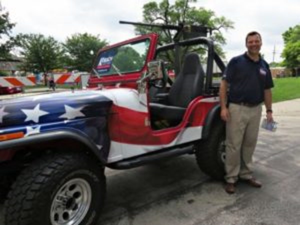 On June 2, 2018, Kansas Secretary of State and Republican gubernatorial candidate, Kris Kobach rode in the machine gun-bearing Jeep in a parade in Shawnee, Kansas. Some loved it, others thought it was a misstep. Photo via Kobach's Twitter feed