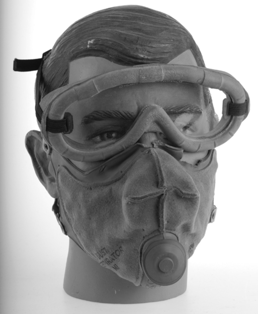 Made of felt filters sewn to the rubber face, it featured a simple, round rubber exhaust valve. Add a pair of goggles and you have the beginning of a good Tennessee Maneuvers or North Africa display. www.AdvanceGuardMilitaria.com