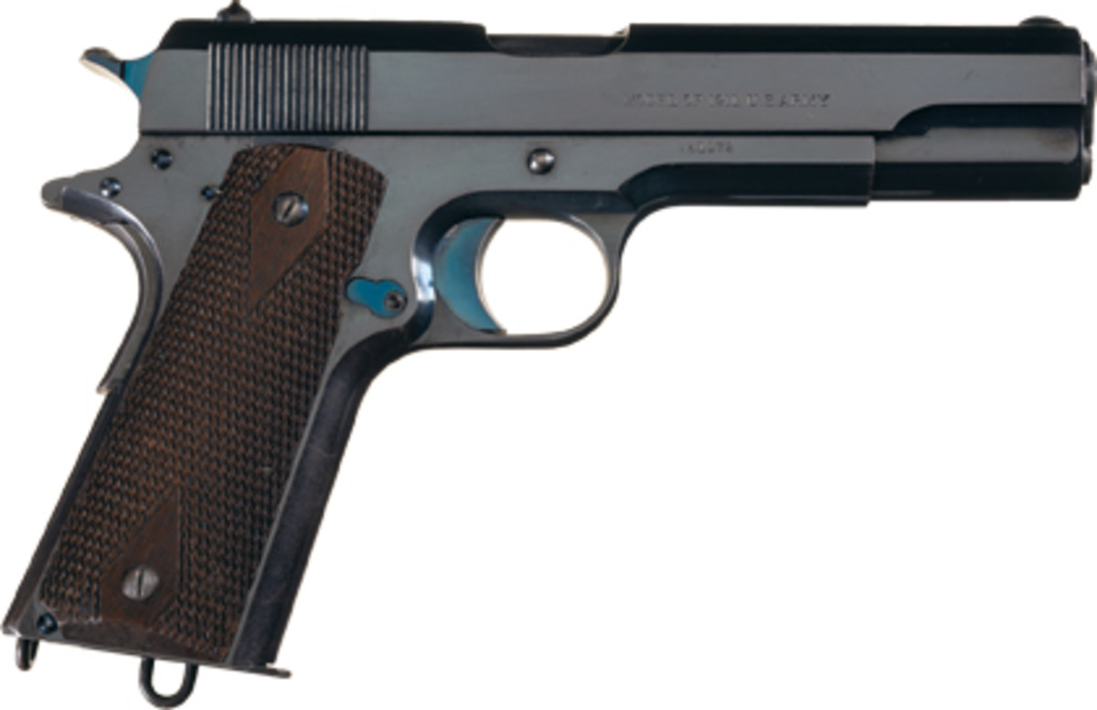 Lot 3559: A stunning first year production Colt 1911, serial #1172, with its mirror-like blue commercial high-polish finish and vivid nitre blue components achieved $69,000.