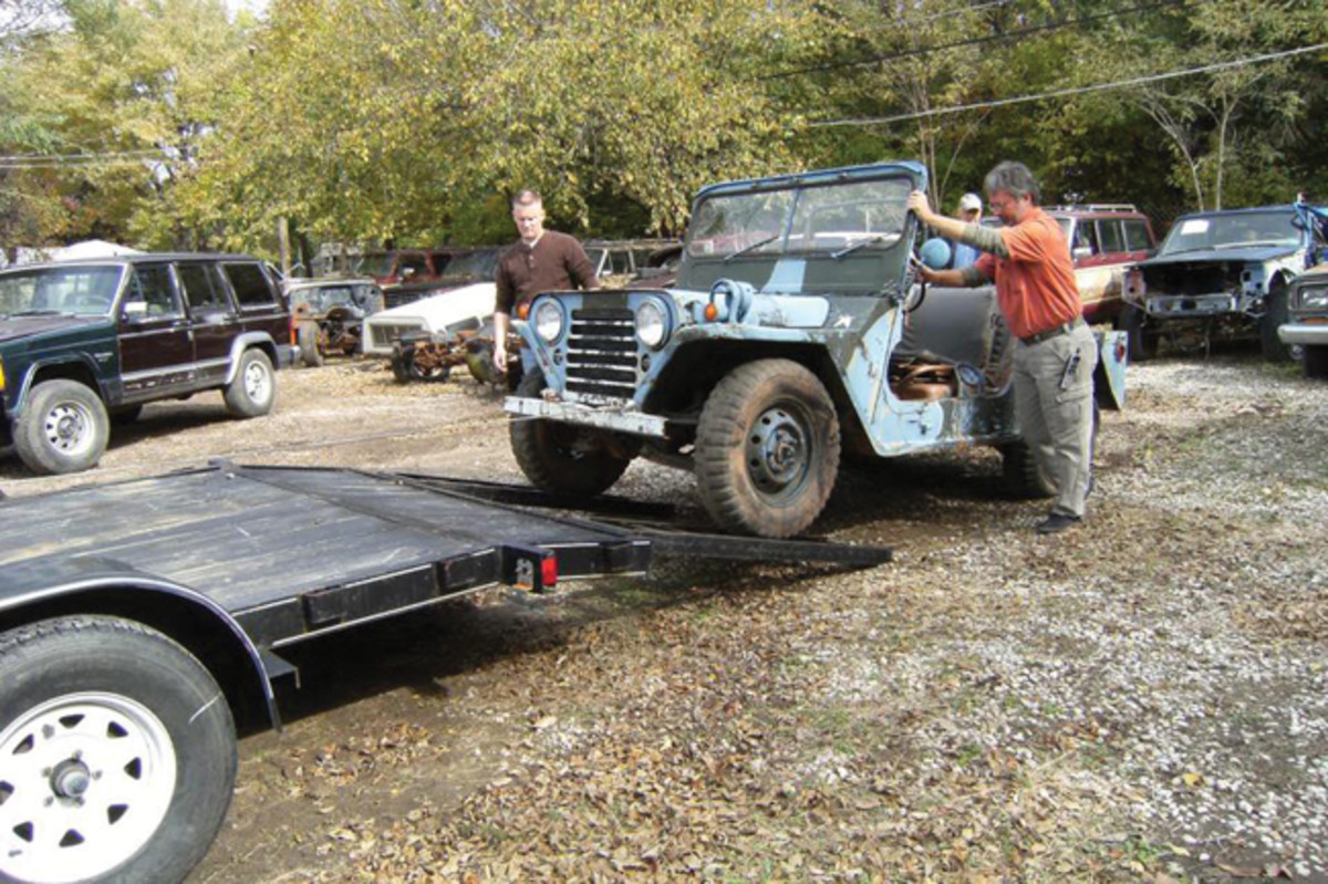 Richard Westbury rolling his unrestored M151 onto a trailer.
