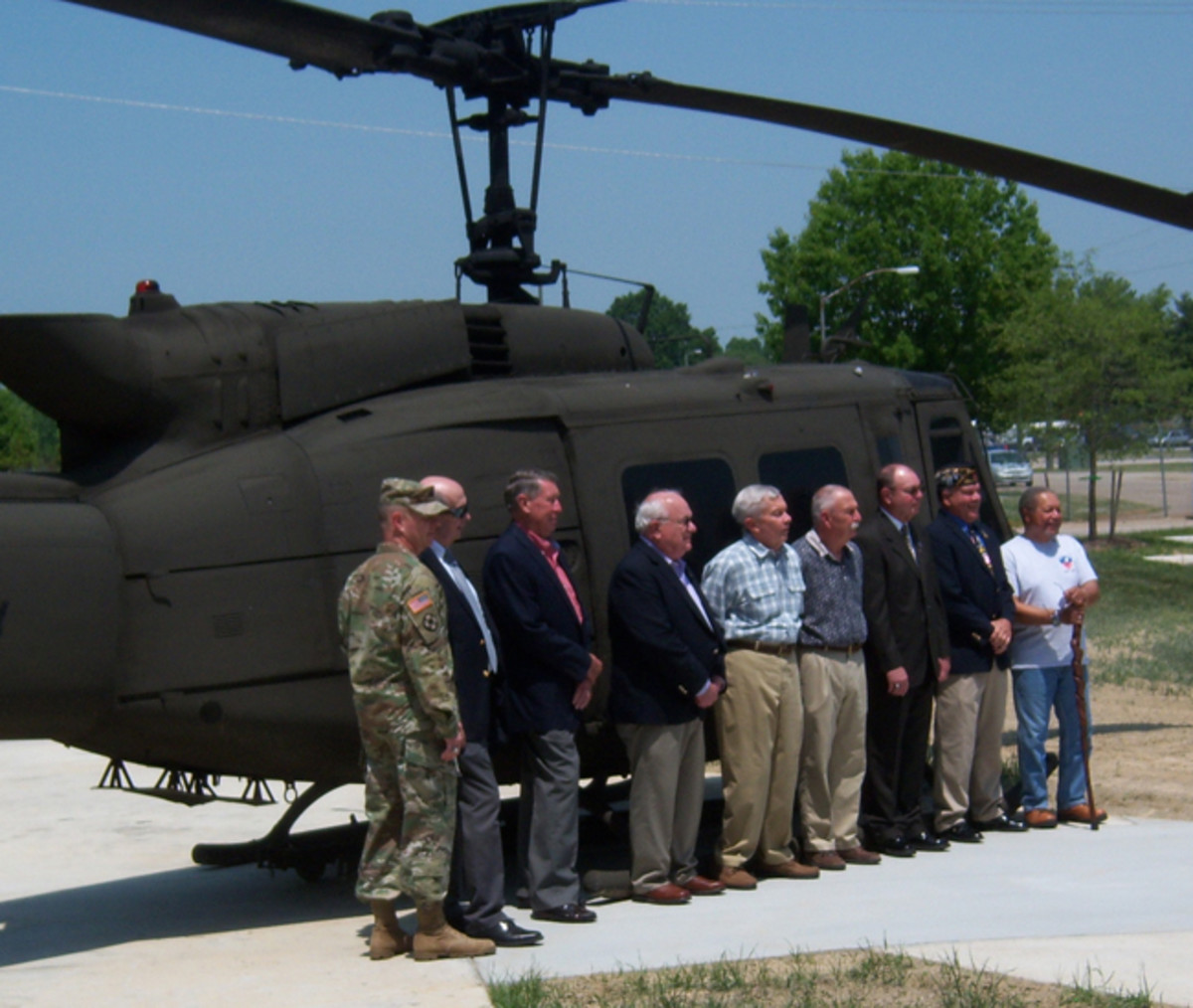 General Williams (on left) poses in front of the UH-1 Huey with some of the Vietnam veterans who were awarded their Vietnam Service pin.